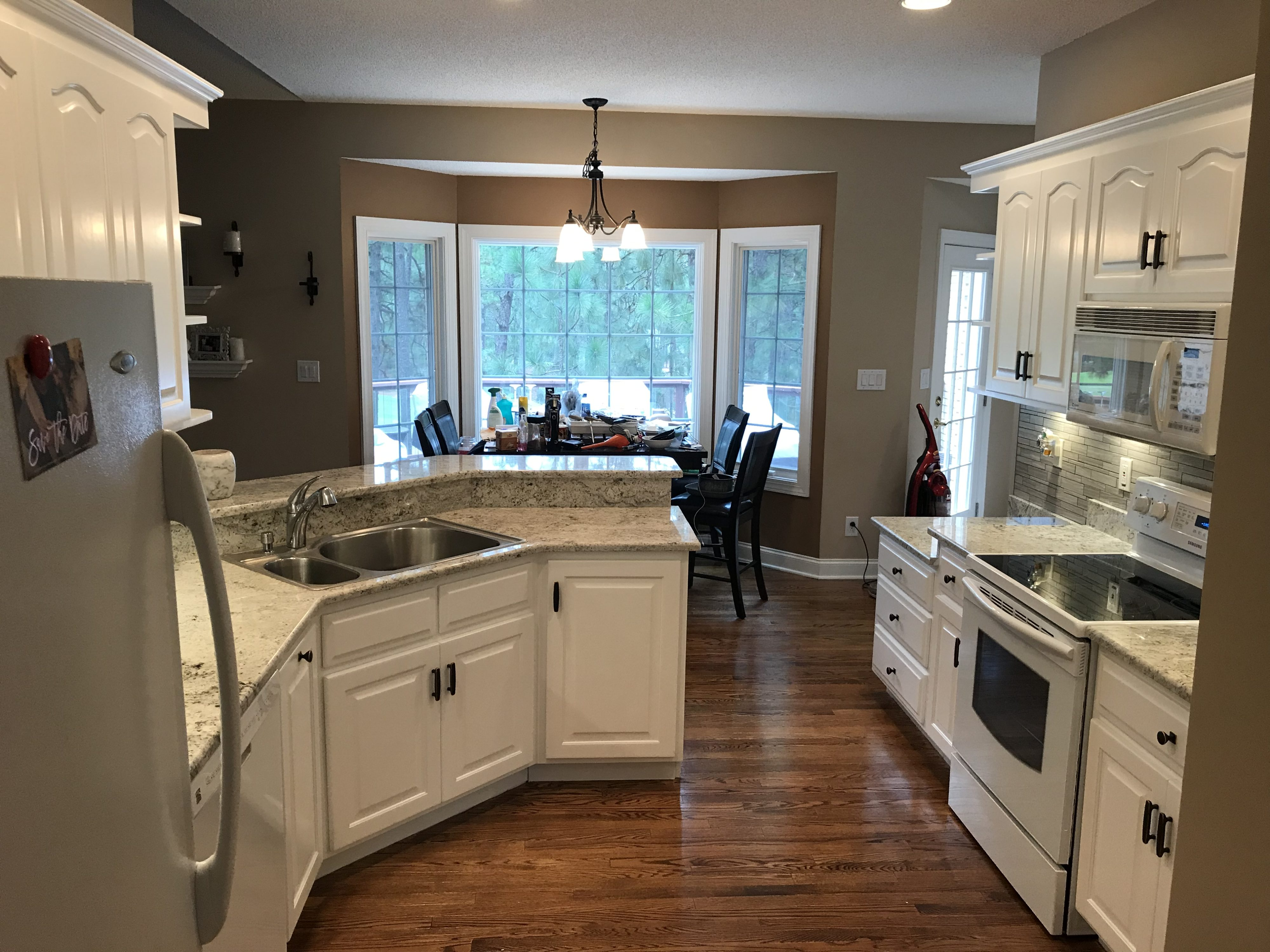 Maple Cabinets Refinished To A Custom White Complete