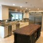 Refinished Cabinets to Modern, Clean & White